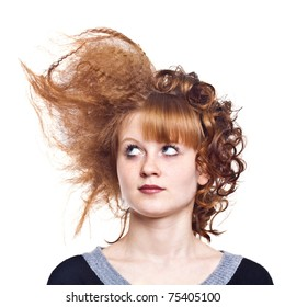 Portrait of the young woman on the isolated white background.Strange hairdress