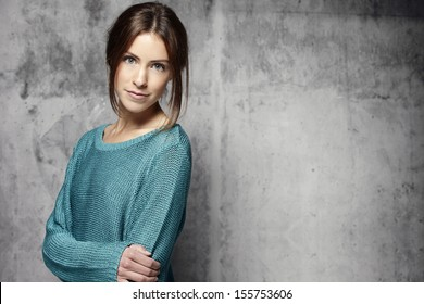 Portrait of a young woman on a rough background