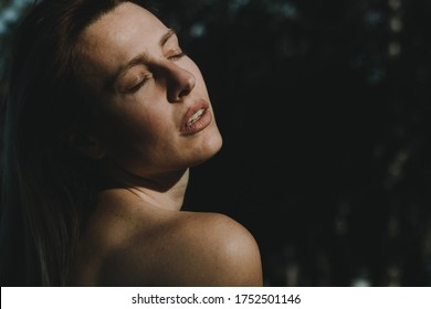 Portrait of young woman on summer sun. Woman with closed eyes