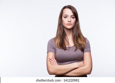 Portrait of a young woman on a white background.