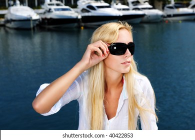 Portrait of the young woman on the yacht