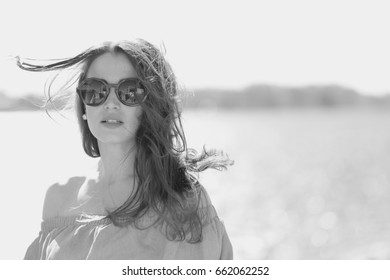 Portrait of a young woman outdoors on a summer day