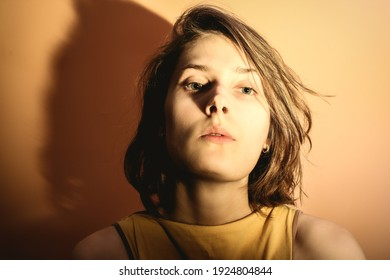 Portrait of a young woman with overexposure. Head thrown back