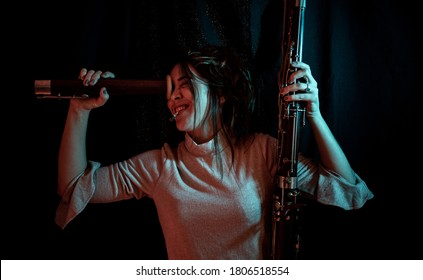 portrait of young woman playing with parts of a bassoon