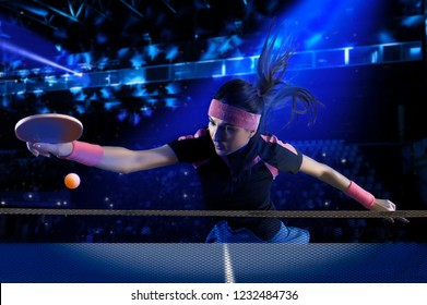 Portrait young woman playing table tennis on dark background with lights