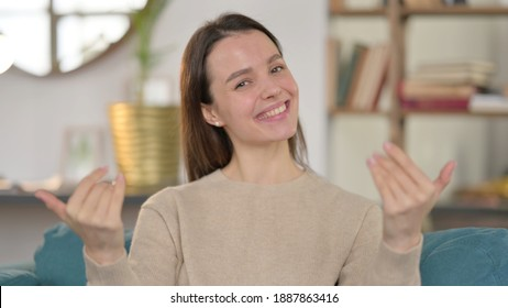 Portrait of Young Woman Pointing and Inviting