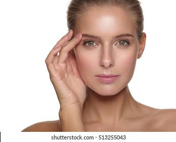 Portrait of a young woman with pure and healthy smooth skin without makeup, who is doing daily cleansing procedures, wellness and spa, white isolated background