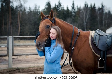 portrait of young woman with red don mare horse
