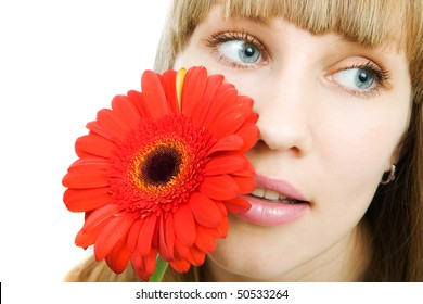 Portrait of a young woman with red flower gerbera