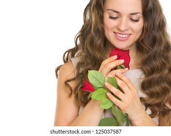 Portrait of young woman with red rose