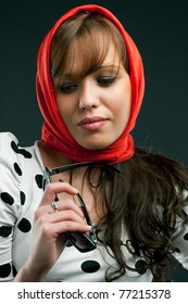 Portrait of young woman with red scarf.