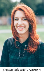 portrait young woman redhead outdoors looking camera smiling - happiness, crefree, customer concept