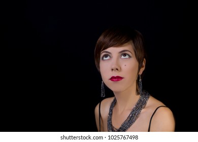 Portrait of a young woman in retro style on a black background