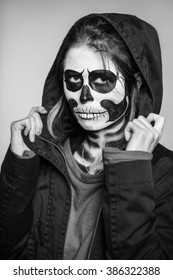 Portrait of young woman with scary makeup for Halloween. Monochrome