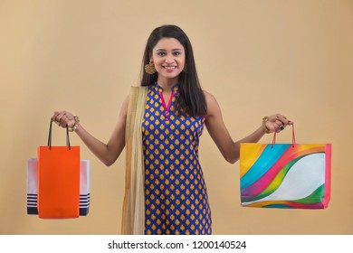Portrait of a Young Woman with shopping bags
