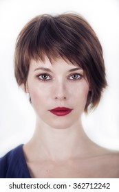 portrait of a young woman with short brown hair on a white background