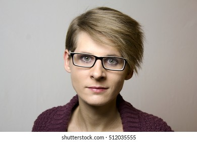 Portrait of a young woman with short hair and eyeglasses