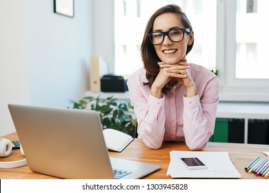 Portrait of young woman sitting in office