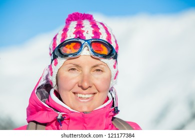 Portrait of young woman a ski outfit at winter outdoor. Tirol, Austria