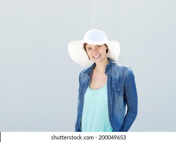 Portrait of a young woman smiling with sun hat