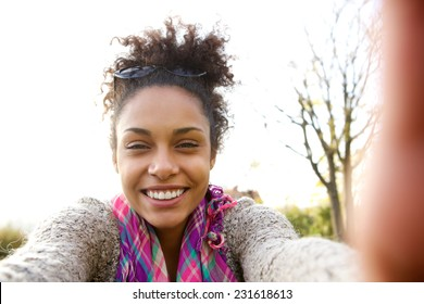 Portrait of a young woman smiling and talking a selfie