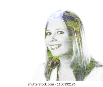 Portrait of a young woman smiling with trees in her hair