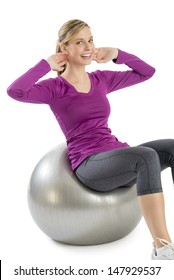 Portrait of young woman smiling while exercising on pilates isolated over white background