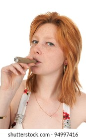 Portrait of an young woman smoking a cigar