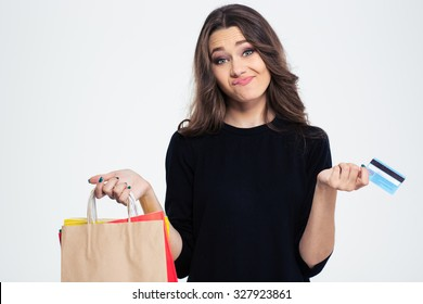 Portrait of a young woman spent all money from the bank card  isolated on a white background