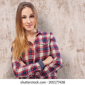 Portrait of young woman standing with arms crossed