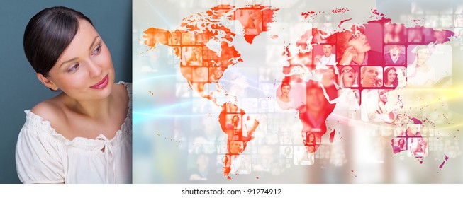 Portrait of young woman standing near big virtual display with world map and lots of photo on it. Network concept