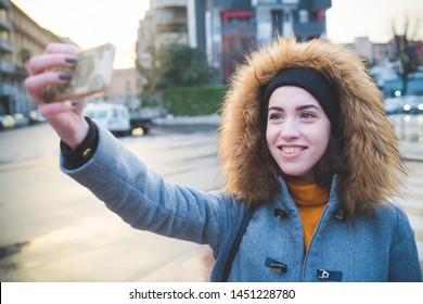 portrait of young woman in the street taking selfie – vacation, diversity, technology