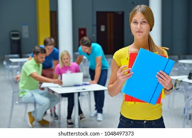 Portrait of a young woman studying at college