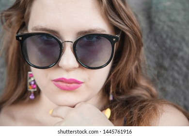 Portrait of young woman with sunglasses.