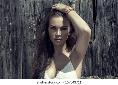 Portrait of young woman at sunny day
