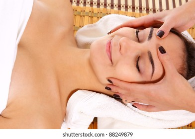 portrait of a young woman taking spa