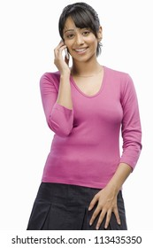 Portrait of a young woman talking on a mobile phone