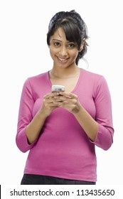 Portrait of a young woman text messaging
