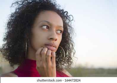 Portrait of young woman thinking