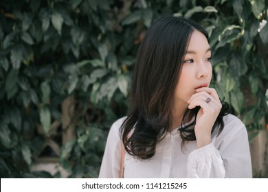 Portrait young woman thinking and looking modern style in outdoor urban background