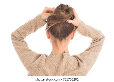 Portrait of young woman tied her hair in bun. isolated