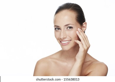 Portrait of young woman touching face, smiling