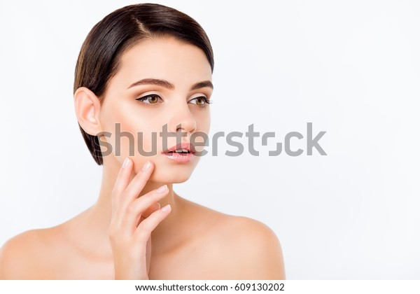 Portrait of young woman touching her cheek.