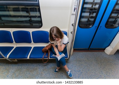 Portrait of young woman tourist in metro waggon