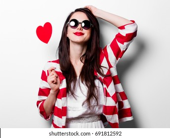 portrait of the young woman with toy heart shape on white background