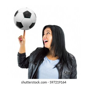 portrait of young woman trainer playing with a soccer ball