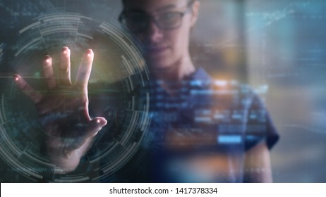 Portrait of an young woman is using the futuristic latest innovation technology with augmented reality hologram. Concept of future, innovation, technology, holographic