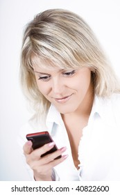 The portrait of the young woman using a mobile phone
