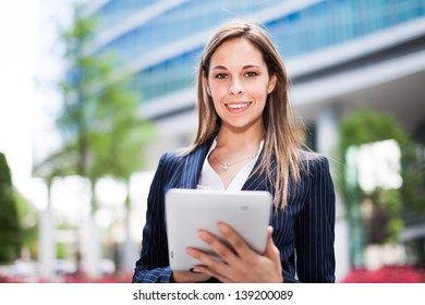 Portrait of a young woman using a tablet