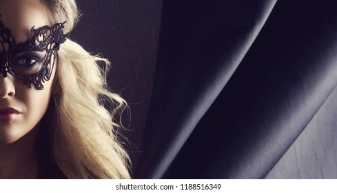 Portrait of young woman in vintage mask. Attractive blond girl with beautiful hairstyle.
